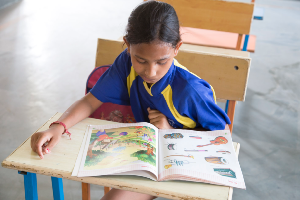 This little girl is getting an education thanks to the work of Apneaap.